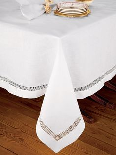 Chateau Blanc Table Cloth - Luxury Table Cloths - The intrinsic elegance of 100% pure linen from Italy celebrates the expert artisanry of magnificent hand-drawn hemstitched inserts