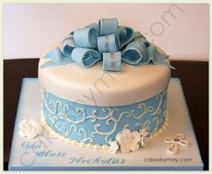 This beautiful and elegant baptism cake was selected for Nickolas baptism.  I love the strings of rhinestones on the loopy bow and on the cross.  It gives  it a little sparkle.  Chocolate cake with hazelnut filling.