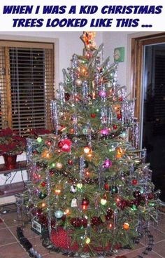 vintage christmas tree with tinsel and 1950s christmas balls lionel train running around the