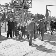 German prisoners of war from Elverum camp prepare for embarkation from Norway to Germany. Before leaving the embarkation camp at Mandal a final screening of prisoners was carried out by walking the prisoners past two Gestapo men and one 'Quisling' woman who were to identify any of their former colleagues trying to pass themselves off as ordinary German soldiers.