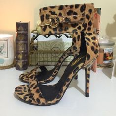 "Leopard Print Patent Leather Sandals Never worn. Price sticker still on shoe. Ankle cuff sandal with a patent leather. About a 4"" heel. No trades.  No pp. Charlotte Russe Shoes Sandals"