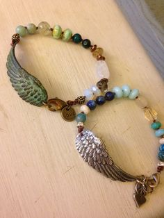 Silver plated  or patina angel wing peace baby boho bracelet ,65.00
