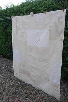 Hand embroidered and lace quilt.