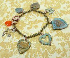 http://www.ornamentea.com/TheShop/TutorialPages/PatinaBrassHeartBracelet.html  Patina Brass Charm Bracelet Tutorial