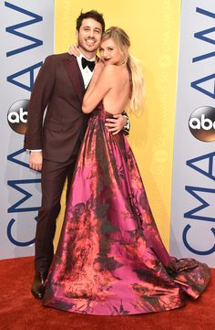 Kelsea Ballerini & Morgan Evans from Red Carpet Couples at the 2016 CMA Awards  This country cutie is holding on to her beau like she means it.
