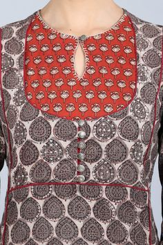 With our latest kantha kurta collection, you can stay comfortable while flaunting your style. You will adore this classy combination of grey, red and off-white; a sophisticated straight-cut kurta with a standout bodice design. The delicate neckline and bu