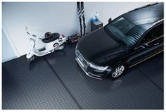 """Bergo Tiles solves problems with cold, damp and dull floors. The Bergo Tiles allows the surface underneath to """"breathe"""", which prevents moisture being trapped and odours forming. You can easily perform the installation yourself. Garage Boden, Tile Floor, Flooring, Breathe, Tiles, Surface, Rug, Cold, Vehicles"""