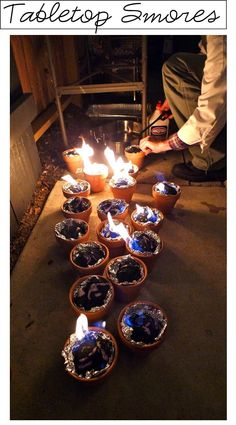 Put charcoal into foil lined terra cota pots and you've got a tabletop fire for Smores..... INTERESTING