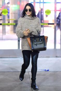 Vanessa Hudgens wearing Celine Smooth Calfskin Tricolor Micro Luggage Khaki, Dolce Vita Zachary Moto Booties, Wilfred For Aritzia Montpellier Sweater in Vagabond Mix, BCBG Francisco Faux-Leather Blocked Leggings and L.G.R Handmade Elliot Round Metal Sunglasses