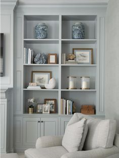 Southern Home Interior light blue living room design // light blue living room built in shelve and cabinets.Southern Home Interior light blue living room design // light blue living room built in shelve and cabinets Built In Shelves Living Room, Bookshelves Built In, Living Room Cabinets, Bookcases, Living Room Interior, Living Room Decor, Cheap Home Decor, Home Remodeling, Living Room Designs