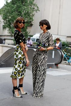 taken by Tamu McPherson. Not sure I'd have the nerve to wear it but the outfit on the right is darling.