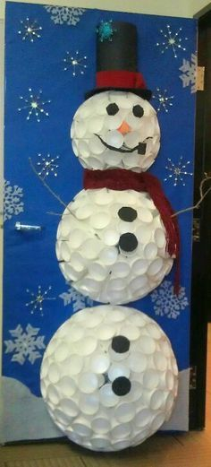 Snowy the Snowman by Bonnie & Cristina.  Inspired by a Styrofoam cup snowman found on Pinterest. Created my own to enter it into our Holiday office door decorating contest. 140 16 oz cups plus 50 8.5 oz cups for the head. Tricky and time consuming but TOTALLY worth it.