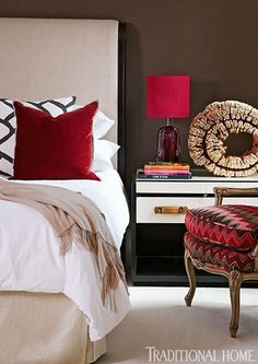 A piece of petrified wood adds artistic sensibility to this contemporary nightstand from Jerry Pair - Traditional Home® / Photo: Lauren Rubinstein / Design: Bill Musso & Lauren Dott
