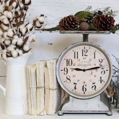 -Reproduction - Inspired by Vintage grocery scales-Made of metal and glass with rustic finish-It features a functional clock, scale is decorative only-Dimensions (when assembled): 10