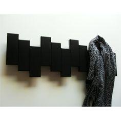 perchero de pared moderno lacado en color negro muy decorativo lo encontrars en www
