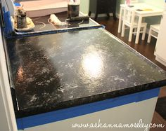 Love this super easy way to redo your countertops!  Its Giani Granite Paint for Countertops and I found it on Ask Anna - www.askannamoseley.com