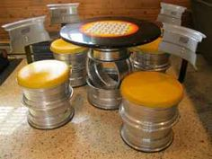 Table and chairs from tire rims. **** Another man cave idea!****