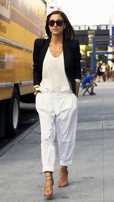 Team a black blazer with white chinos for a standout ensemble. Dress down your look with tan suede gladiator sandals. Shop this look for $292: http://lookastic.com/women/looks/blazer-and-chinos-and-gladiator-sandals-and-tank-and-statement-bracelet-and-sunglasses/2467 — Black Blazer — White Chinos — Tan Suede Gladiator Sandals — White Tank — Gold Statement Bracelet — Dark Brown Sunglasses