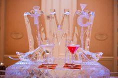 custom monogram martini ice luge for wedding reception cocktail hour