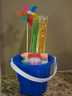 End of preschool gift for students - bubbles, freeze pops, sidewalk chalk, pinwheel, then write student name with paint pen - could also add an inflatable beach bowl