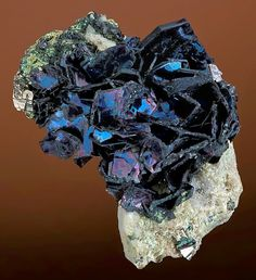 Brilliant cluster of iridescent Covellite on Quartz matrix! Also with Pyrite, From the Leonard Mine, Butte, Silver Bow County, Montana.