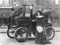 "English (Jersey/Channel Islands), born actress, of the stage and a producer, Lillie Langtry, (1853-1929). She became know for her talent and beauty in America as well, and arrived in NYC, c.1882, during America's Gilded Age era. Shown here aside a battery operated electric, NYC  taxi cab, c.1901. ~~ {cwl} ~~ (sourced image - e-book ""Electric Vehicle Technology Explained"" - authored by: Larmine & Lowry)"