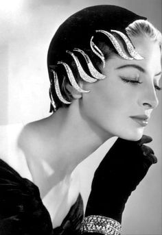 Capucine wearing hat by Jean Barthet lined with a row of diamond 'flame' clips by Van Cleef & Arpels who created this look for her in 1954