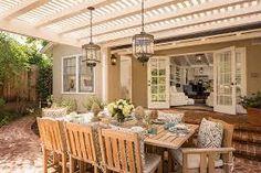 Lanterns over dining table on verandah www.decoist.com
