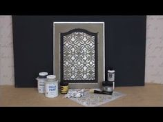 How to Stencil Tutorial (VIDEO): DIY Distressed Silver Leaf Cabinet Door - Learn how to use stencil size and metal leaf to create a metallic antique look to stenciled and painted wood furniture