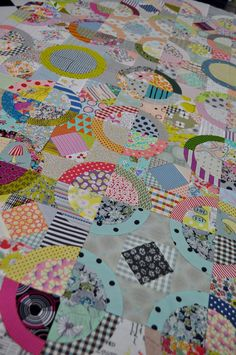 """Taught by Jen Kingwell Class Description I have made this one especially for the retreat. Circles upon circles. A really fun way to play with fabric choices. Template cut and hand pieced or you could machine if desired. Supply List Quilt measures 66"""" 167.5 cm 4-5 yds total of a wi"""