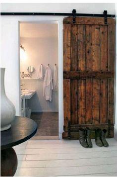 Vintage door on rollers.
