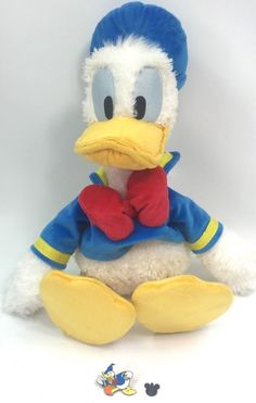 "Walt Disney World 18"" Donald Duck plush with bonus pin. Donald is wearing a blue shirt with red bow tie and attached hat. Pin is the Angry Donald shaking his fist from 20. 