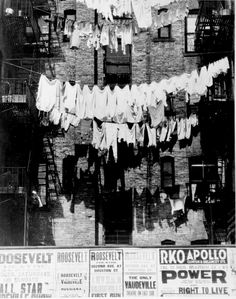 Rows of laundry outside a New York City apartment house, 1935