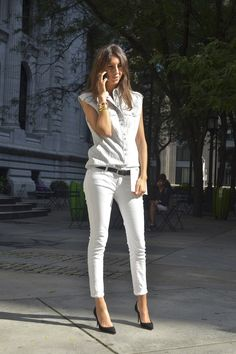 Geraldine Saglio- The Vogue Paris editor in a denim muscle blouse, belted cropped white skinny jeans and black pumps.