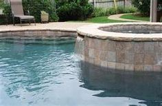 I'm looking for different ideas for our swimming pool tiles.  I don't like what's on it and would like to change to a more natural stone look.