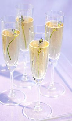 Lavender in Champagne--perfect idea for summer entertaining.  Would work nicely with any fragrant flower