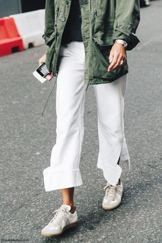 Army jacket and white trousers