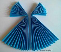 L' angioletto realizzato con la carta piegata a mò di ventaglio è un'idea vista da qualche parte sul web... ma non ricordo precisamente su ...