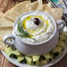 """Let me start by apologizing for not posting this sooner. I know I've promised you all sorts of Greek recipes, so starting today I am going to deliver! First things first…. Tzatziki. This is a classic Greek appetizer (or """"meze"""") made from thick strained yogurt, cucumber, garlic, olive oil, and fresh dill. It's super simple …"""
