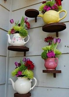 Old Tea Pots and cut flowers looks nice anywhere.