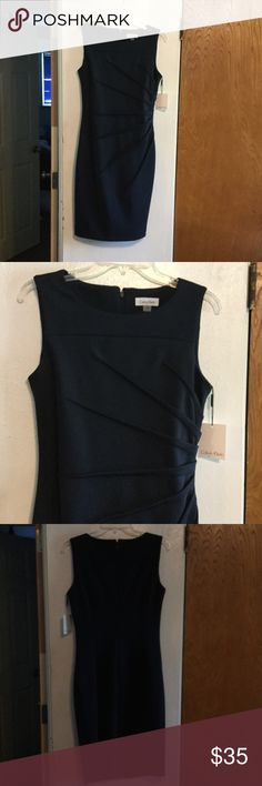 NWT lovely CK sheath This dress is super flattering with sunburst accents on side. It is fitted and made of a polyester spandex blend, making it a little stretchy. Color is navy and fit is fantastic! Calvin Klein Dresses Midi
