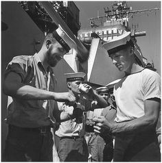 The Royal Navy lads getting the daily tot.
