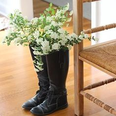 Place water-filled mason jars in the bottom of boots as a unique vase for spring blooms!