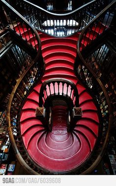 The view inside a Portuguese book shop.... i want this stair case in my house
