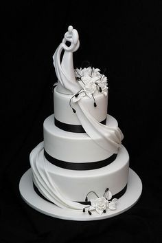 Instead of just placing your cake topper on the top, make it part of the design. The Bride's dress drapes into accent drape on cake, a smooth transition.