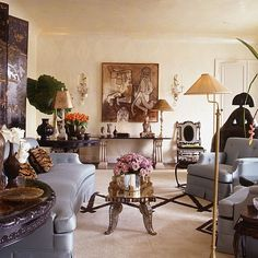 Room of the Day ~ Albert Pinto: Paris apt ~ love ice blue curved sofa, black screen, tiger pillows, silver coffee table and black and silver accents 3.22.2014