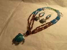 Turtle necklace and earring beaded set in browns blues and greens