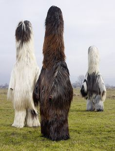 Babugeri and Chaushi, Bulgaria. The bizarre-looking costumes are made from goat skin. Traditionally, they carried a red-painted rod on their belt to represent a phallic object and would brush up against women to make them fertile. Now they just carry a stick. Photo: Charles Fréger