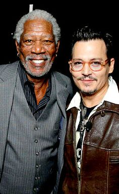 Johnny Depp and Morgan Freeman at CinemaCon on March 27, 2014.