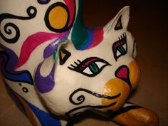 cat made with a bottle, a can and papier maché